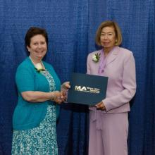 <I>Linda Walton, MLA President and Naomi C. Broering, PCOM's Dean of Libraries</i>