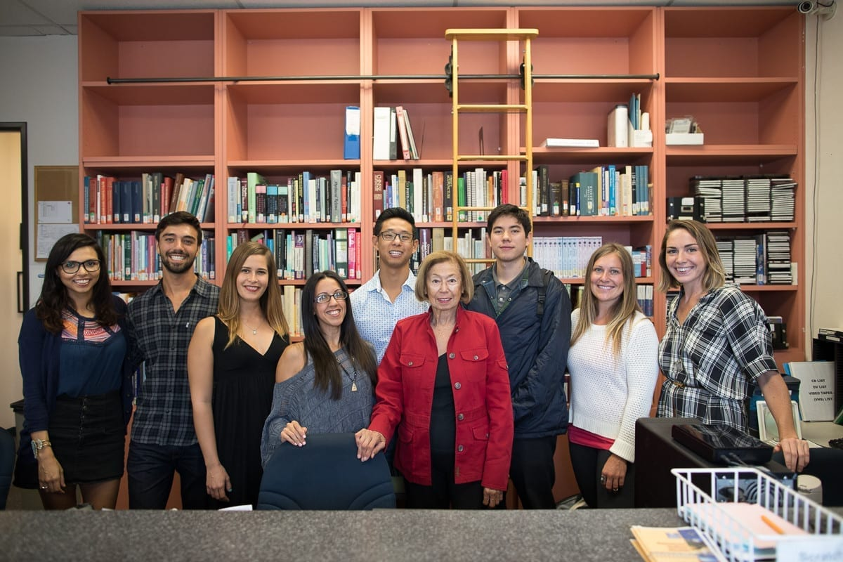 staff and interns in library