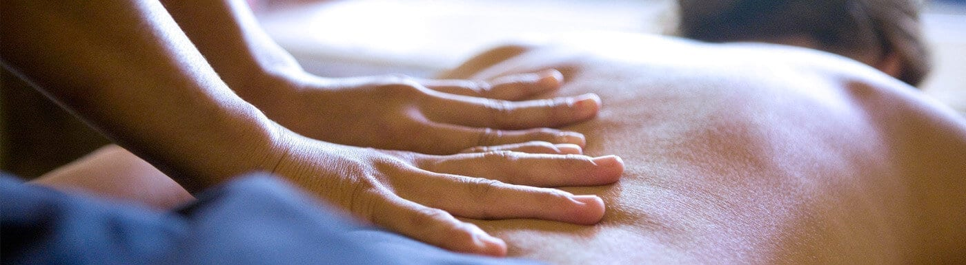 Patient receiving back massage