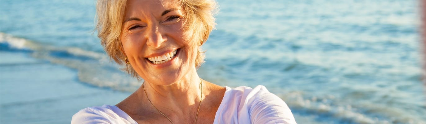 Woman smiling by the beach