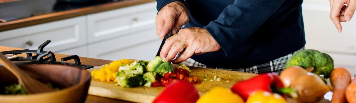 Man cutting vegetable