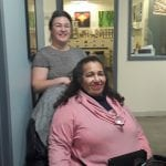 Photo of Elena Tate (rear, Clinical Supervisor) and Ms. Jeanette Jones (seated, client). Photo by Nicolas Arenas.