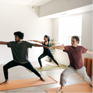 A diverse group of people doing yoga