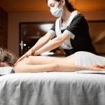 Massage Therapist doing massage to a client